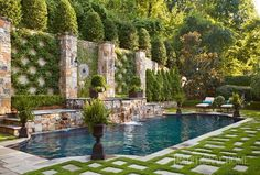 Neatly clipped arborvitae and boxwood classic geometric lines and beautiful symmetry give this backyard oasis its distinctly traditional look Photo Jean Allsopp Design. Modern Landscape Design, Modern Landscaping, Backyard Landscaping, Landscaping Software, Landscaping Around Pool, Boxwood Landscaping, Modern Design, Sloped Backyard, Landscaping Company