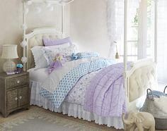 This girls' bedroom is the perfect blend of old-world charm and modern elegance