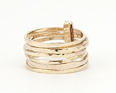 A personal favorite from my Etsy shop https://www.etsy.com/il-en/listing/237508139/hammered-skinny-ringsset-of-7-rings