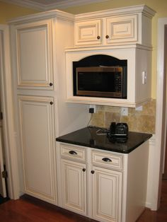 Kitchen Cabinets- I like the microwave cabinet.