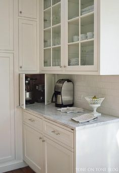 corner kitchen furniture. love the clever corner cabinet storage for appliances honed carrara marble countertop benjamin moore super white walls and trim glass front chrstiana kitchen furniture l
