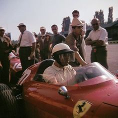 Phil Hill, who took the chequered flag in the race, in his Ferrari.