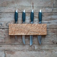 Beautiful handcrafted holder for your beloved kitchen knives. Thick solid knife racks for the serious home chefs who prefer to keep their best knives away the metal used on magnetic knife holders. Having pets and children in my kitchen I also prefer my carving knives are held