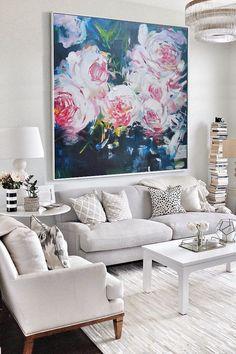 Large floral statement art in living room