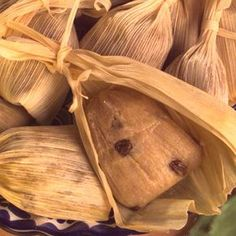 Sweet Tamales  1 pkg. (8 oz.) dried corn husks 1 cup lard or shortening, divided 2 1/2 cups masa harina flour (Mexican corn masa mix) 1 1/2 cups yellow corn meal 1/4 cup granulated sugar 1 tablespoon ground cinnamon 2 teaspoons salt 1 1/2 cups water 1 can (14 oz.) NESTLÉ® CARNATION® Sweetened Condensed Milk 2 teaspoons vanilla extract 1 cup raisins 1/2 cup chopped walnuts Directions:
