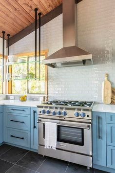 Light blue shaker kitchen cabinets in contemporary style kitchen