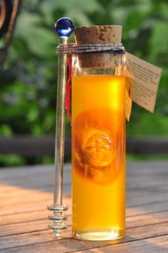 This little vial of honey could sit on my table any day. Love that amber glow of honey goodness. Someday I'll own bees.