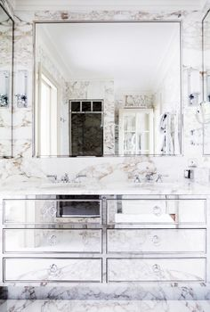 20 Must-Know Terms for Buying the Perfect Mirror | DomaineHome.com // Beveled mirror in marble and mirrored bathroom.