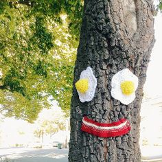 who doesn't think to put a smiley face made out of knitted breakfast foods on a tree?