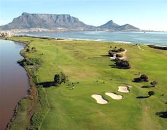 Milnerton Golf Club with Table Mountain and Table Bay in the background and the Milnerton Lagoon on the left of the photo. Public Golf Courses, Best Golf Courses, Cape Town Tourism, Coeur D Alene Resort, Cape Town South Africa, Table Mountain, Dream City, Most Beautiful Cities, Once In A Lifetime