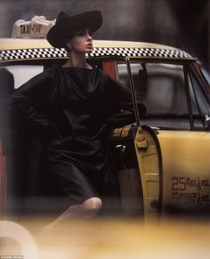A woman steps out of a Yellow Taxi looking ever so chic, in 1962 - NYC