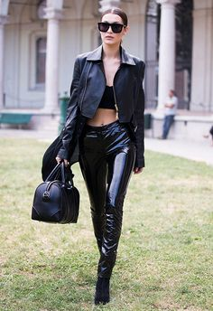 Bella Hadid wearing black PVC pants, a black crop top and leather jacket   ASOS Fashion & Beauty Feed