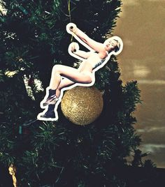 Miley you have been promoted to Christmas Tree decoration... congrats! #Miley #Cyrus #Tree #Decoration #bauble #WreckingBall