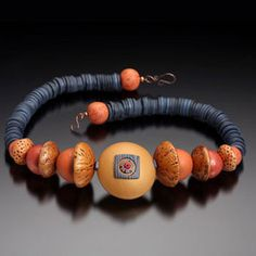 Loretta Lam - Polymer-like the use of acorn shapes, and color combo
