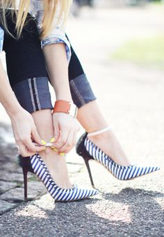 Navy Striped Pumps!  Dress up or down....maybe a white shear blouse with a navy bandeau underneath or a pop of red!