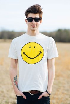 All smiles from our #UOonYou stylist John in UO's distressed smiley tee. #urbanoutfitters