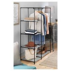 Create additional garment storage in your home with Whitmor's Spacemaker Wardrobe. Equipped with a metal bar for extra hanging space and five fabric shelves to store folded clothing, shoes and accessories. The freestanding lightweight design provides easy accessibility and is great for small spaces like apartments or college dorm rooms. Get organized and store smarter with Whitmor's Spacemaker Wardrobe.