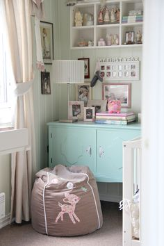 I want to paint a bookcase for Jane some sort of vintage aqua color like this.  I also love how the objects are arranged--lots of stuff but it doesn't look cluttered.