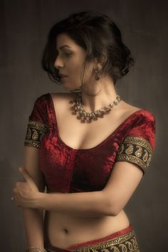 My next sari blouse :-) Hmmm, too bad I wouldn't look like her in it. (Maroon Velvet Blouse by Sabyasachi)