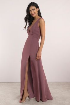 Feel like a million bucks in the Ivy Low Back Maxi Dress. Featuring a low cut and v neck top with a slit. Pait it with a simple long necklace. #shoptobi