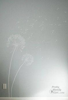 I think I want to paint dandelions in E's room when we upgrade to a toddler bed and redecorate! so whimsical.