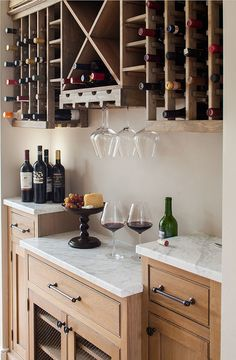 Love this wine bar setup, featuring marble countertops, wooden cabinets, and a built in wine rack Wine Theme Kitchen, New Kitchen, Kitchen Decor, Design Kitchen, Kitchen Ideas, Wine Storage Cabinets, Wine Rack Cabinet, Countertop Wine Rack, Wine Racks