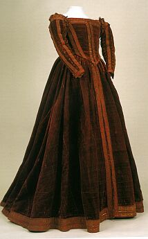 """Believed to be from 1560, this is called the """"Red Dress of Pisa."""" It is a Florentine gown from the sixteenth century - it was found on a wooden effigy at San Matteo. It is housed at the Palazzo Reale di Pisa (Museum Nazionale). It is made of red velvet with gold couched trim."""