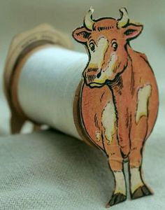 Antique paper trade card Coats & Clark sewing thread advertising.  Toy cow to make with empty spool.