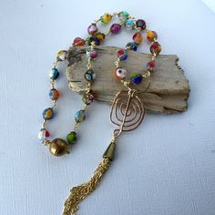 Glass bead and gold wire pendant, colourful bead necklace, elegant gold-tone necklace by LunicaDesignJewelry on Etsy