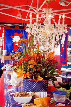 Where else might you find a chandelier hanging in the middle of a tent? The Grove on Game Day of course.... Ole Miss Tailgate