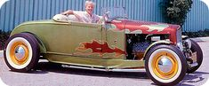 """George Barris - Used in the """"Dragnet"""" TV show, originally painted red, Barris repainted it after the show in lime metallic with rust flames to the grille, shell lights and fenders. It was flathead powered and featured a chopped T windshield and neat streamlined door hinges."""