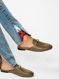 Gigi Slip-On Loafer   Sophisticated and modern, these leather slip-on loafers feature gold-toned metal hardware. Padded footbed and a small stacked heel.