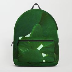 """Cactus On Cyan Background Backpack by ARTbyJWP via Society6 #backpack #backtoschool #cactus #green #bag --  Our Backpacks are crafted with spun poly fabric for durability and high print quality. Thoughtful details include double zipper enclosures, padded nylon back and bottom, interior laptop pocket (fits up to 15""""), adjustable shoulder straps and front pocket for accessories. Dry clean or spot clean only. One unisex size: 17.75""""(H) x 12.25""""(W) x 5.75""""(D)."""