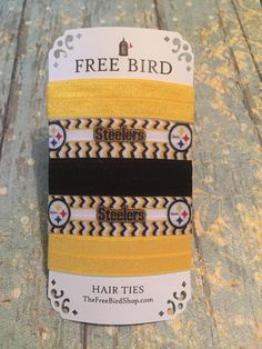 """Show your Pittsburgh pride with this fun 5 pk of fold over elastic hair ties. Each tie is flamed seared to prevent ends from fraying and measure approximately 2.5."""" Ships free with promo code: FREEBIR"""