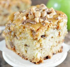 Toffee Caramel Apple Cake is a delicious fresh apple cake recipe topped with caramel and toffee bits. Looks amazing!