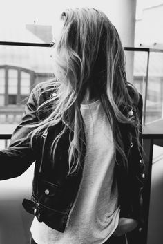 Leather jacket and messy hair. B&W.