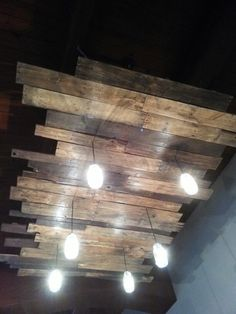 Big Chandelier made from Recycled pallet wood for a local restaurant in Bakersfield Ca,   $1200.    8' X 7'    '_'