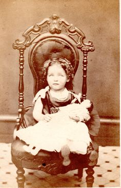Beautiful little girl with her doll. 1860s