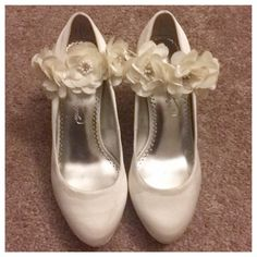 """David's Bridal Wedding Heels Worn once for prom, shimmery ivory satin material, comes with two elastic floral bands that can be worn a few different ways or not at all. 3"""" heel with 1/2"""" platform, surprising very comfortable. A couple of small damage spots shown in the last pic. Shoes Heels"""