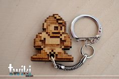 Laser cut and engraved Megaman wood keyring por TwikiConcept
