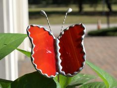 This item is a handcrafted Butterfly Plant Stake cut from AUTHENTIC Stained Glass in the color of Red with white swirls. I have included a photo with three of these Red Swirled Butterflies to show how beautiful they are when placed in a Potted Houseplant.  There is a copper rod soldered into the back of the butterfly which is completely weather proof and will turn to a nice patina finish. The antenna are handcrafted from twisted tinned copper wire and soldered to the body of the butterfly…