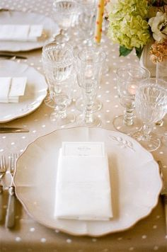 A swiss dot table cloth paired with vintage tableware
