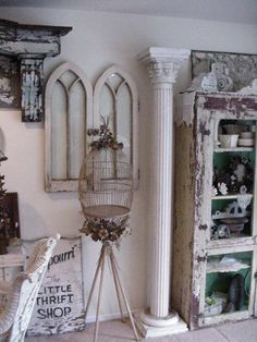 love the gothic styled windows, old chippy cabinet and column
