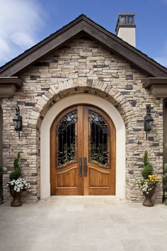 Front entry door from the private courtyard custom built for the unique and traditional homeowner.