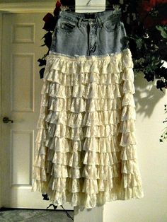 This Belle Bohémienne jean skirt is one of my line of Renaissance Denim Couture, the name I chose for my line of couture because I take vintage denim and give it new life with French bohemian flair.  (This listing is for a made to order jean skirt as pictured, but in your size and desired length.)  To make this Renaissance Denim couture, I took a pair of vintage Guess jeans and formed a yoke at the top.  Then, I made LOTS of gorgeous, ruffled layers of vintage beige French lace, inspired by…