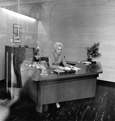 Blonde receptionist behind a picture window, N., 1962 / Eight Diane Arbus Images You've Never Seen - The New York Times Diane Arbus, Greenwich Village, Les Oeuvres, Black And White, Pictures, Image, Furniture, Receptionist, Design