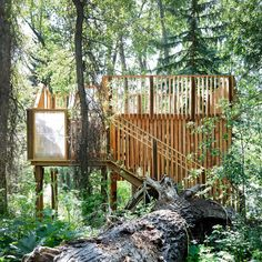 A dilapidated treehouse in Aspen has been rebuilt using vertical wooden slats and translucent panels by Charles Cunniffe, with help from the community.