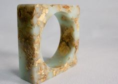 mint gold resin square bangle w/ suspended gold leaf.