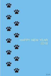 歩く犬の足跡の年賀状
