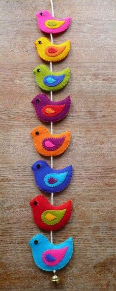 A garland full of sweet colorful birds. Hand cut from wool felt, delicately embr… A garland full of sweet colorful birds. Hand cut from wool felt, delicately embroidered on both sides and finished of with a metal bell. Felt Diy, Felt Crafts, Fabric Crafts, Sewing Crafts, Sewing Projects, Craft Projects, Diy Crafts, Craft Ideas, Stick Crafts